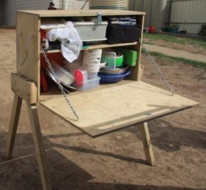 Wooden patrol box with fold-out table and legs